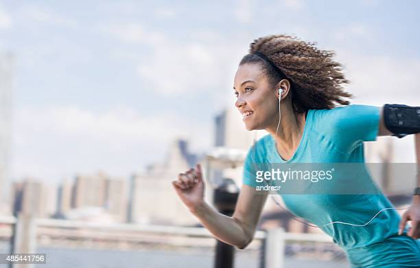 Young black woman running outdoors