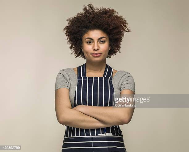 Young black woman wearing apron