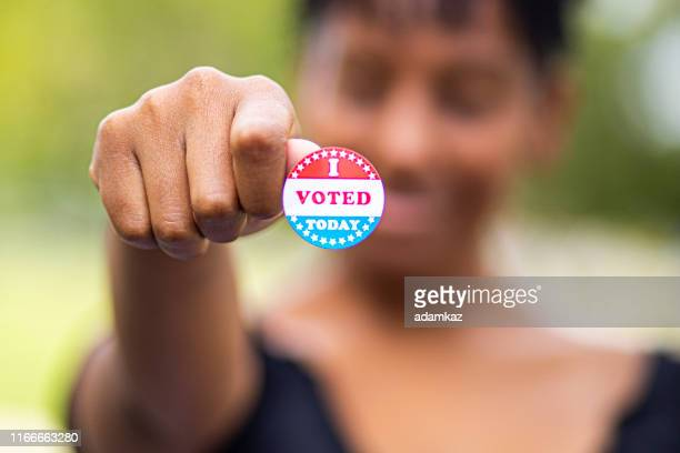 young black woman with i voted sticker - democratic party usa stock pictures, royalty-free photos & images