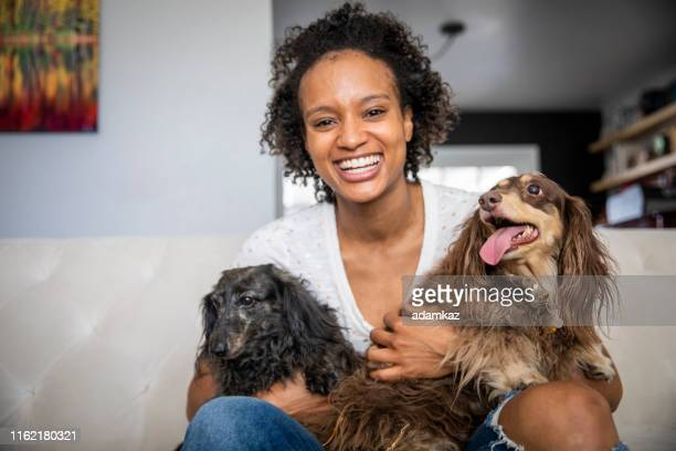 young black woman with pet dachshunds - two animals stock pictures, royalty-free photos & images
