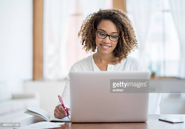 young black woman working at home - using laptop stock pictures, royalty-free photos & images