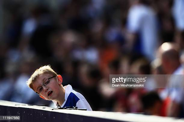 A young Blackburn fan looks on during the Barclays Premier League match between Blackburn Rovers and Birmingham City at Ewood park on April 9 2011 in...