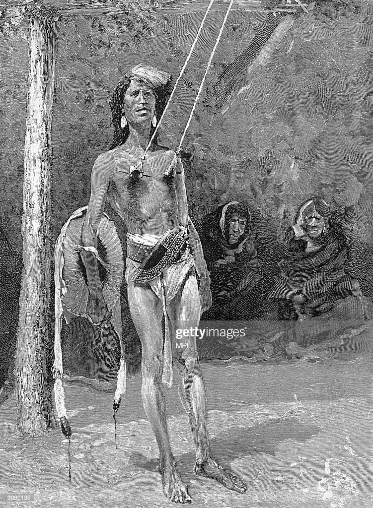 A young Blackfoot Indian being subjected to the ritual of