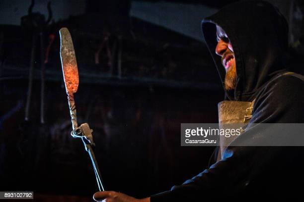Young Blacksmith Holding Glowing Knife Iron Blade
