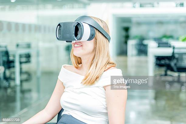 young blond businesswoman has vr headset in office - vanguardians stock pictures, royalty-free photos & images