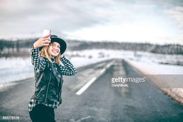 young blond hipster girl with hat making selfie - hot women pics stock pictures, royalty-free photos & images