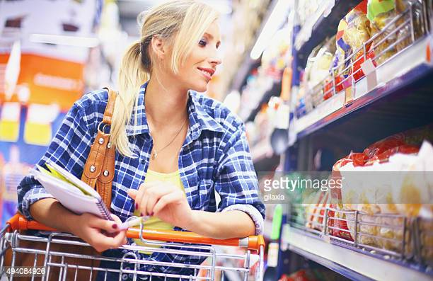 Young blond woman buying food.