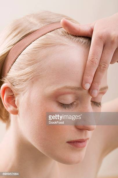 Young, blond woman doing relaxation exercise