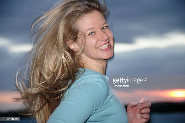 Young blond woman jogging at the beach, portrait
