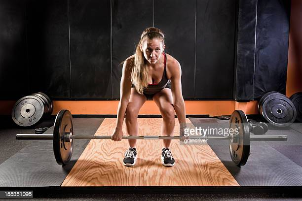 Young Blond Woman Lifting Barbells