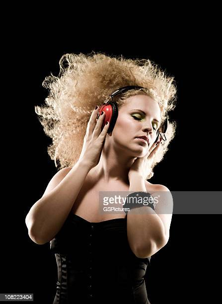 Young Blond Woman Listening to Headphones