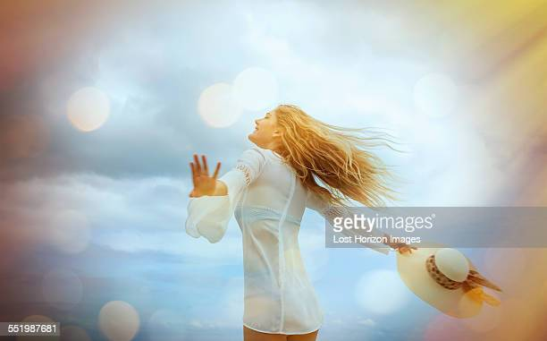 young blond woman running on miami beach, florida, usa - white blouse stock pictures, royalty-free photos & images