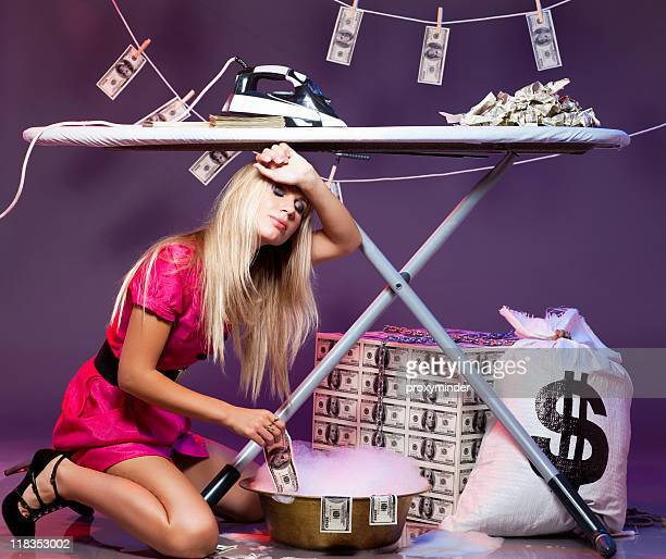 young blond woman tired with money laundering activities - money laundering stock photos and pictures