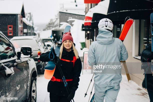 young blond woman walking by car during winter - sweden stock pictures, royalty-free photos & images
