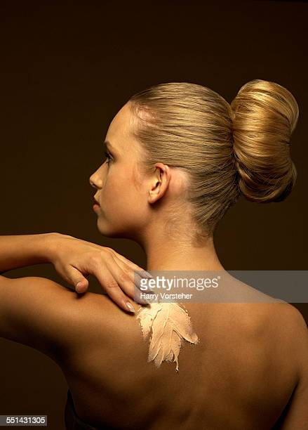 Young Blond Woman with Lotion on Back