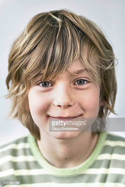 young blonde boy smiling to the cammera.