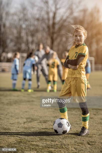young blonde female soccer girl posing for a player photo during football training - team captain stock pictures, royalty-free photos & images