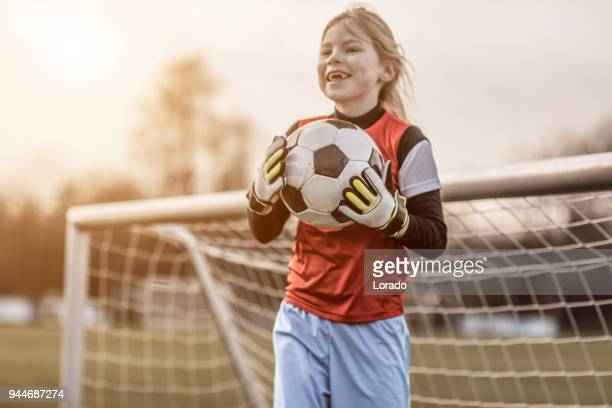 young blonde female soccer goalkeeper girl during football training - goalkeeper stock pictures, royalty-free photos & images