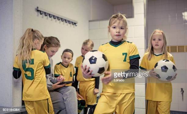 young blonde female soccer player girl during football training - dressing room stock pictures, royalty-free photos & images