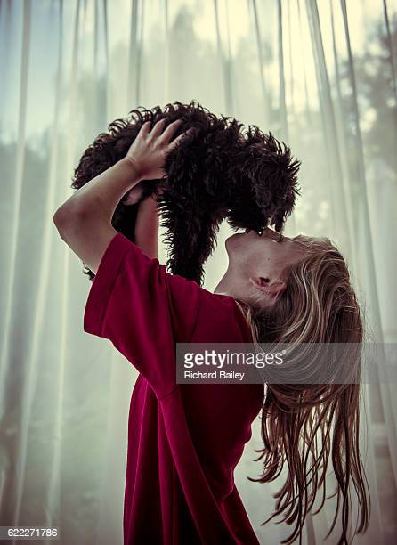 young blonde girl holding a cute puppy. - image stock pictures, royalty-free photos & images