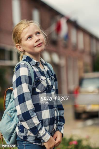 Young blonde girl in a village in spring