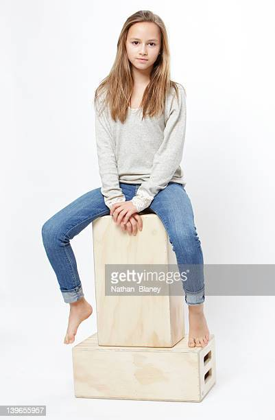 young blonde girl - girls barefoot in jeans stock photos and pictures