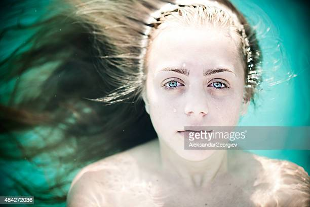 young blonde girl posing underwater with open eyes - drowning victim photos stock photos and pictures
