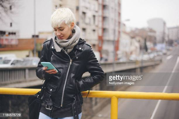 young blonde, short hair, urban woman - androgynous stock pictures, royalty-free photos & images