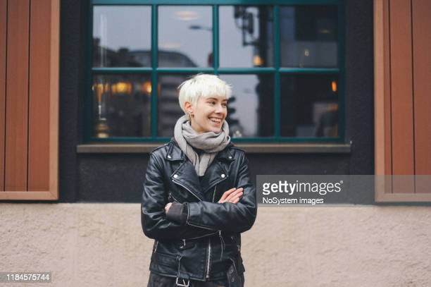 young blonde, short hair, urban woman - gender fluid stock pictures, royalty-free photos & images