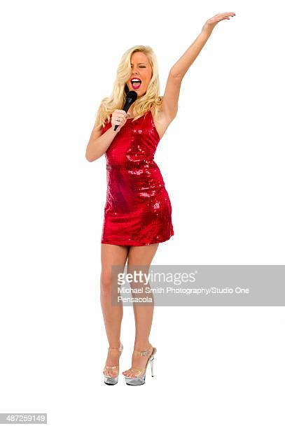 Young Blonde Singer in Red Dress