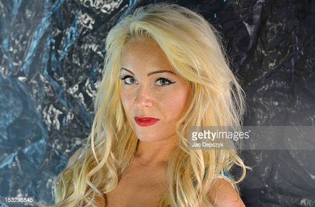 young blonde woman aiming to seduce - depczyk stock pictures, royalty-free photos & images