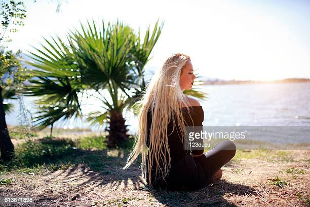 Young Blonde Woman  At Nature