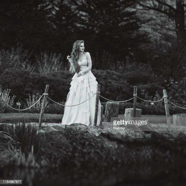 young blonde woman in a natural scenery. - long dress stock pictures, royalty-free photos & images