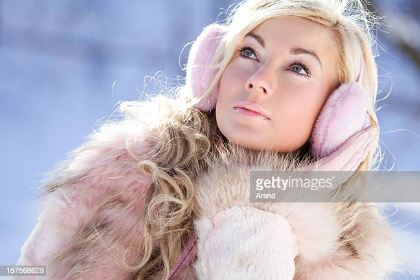 young blonde woman in ear muffs
