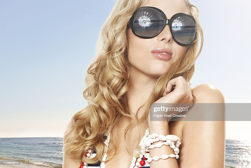 young blonde woman looking out at the horizon : Stock Photo
