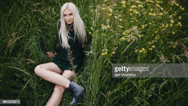 Young blonde woman spending time outdoors