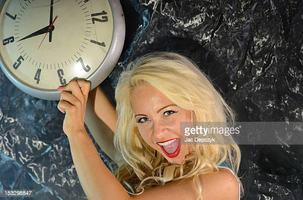 young blonde woman with a broken clock - depczyk stock pictures, royalty-free photos & images