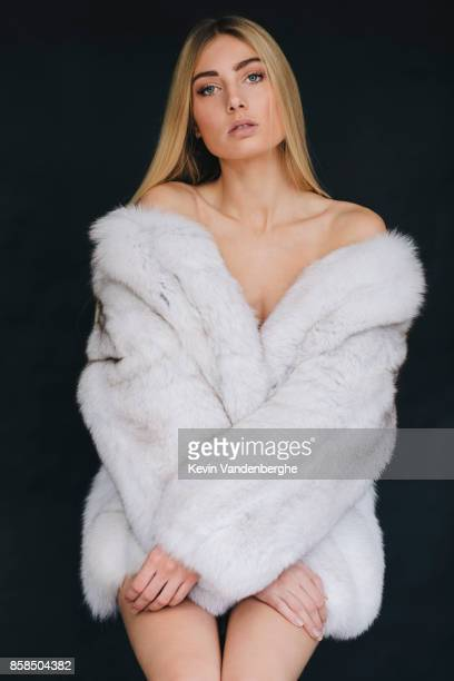 young blonde woman with fur coat