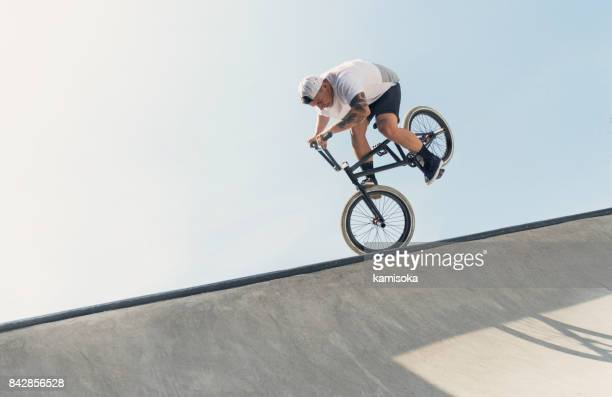 young bmx bicycle rider - stunt stock photos and pictures
