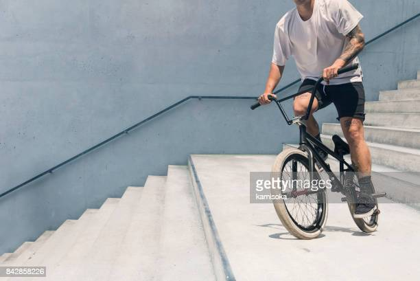 young bmx bicycle rider - bmx cycling stock pictures, royalty-free photos & images