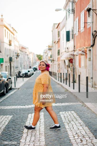 young body positive woman crossing street in city - fat blonde women stock pictures, royalty-free photos & images