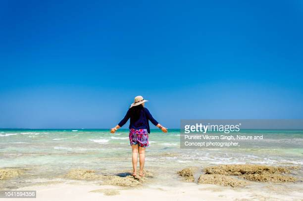 A young body positive woman enjoying the scenic view of beautiful beach in Havelock Island