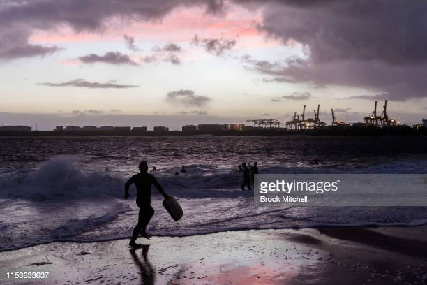 A young bodyboarder sprints to enjoy rare waves breaking inside Botany Bay on June 04 2019 in Sydney Australia The Bureau of Meteorology issued a...