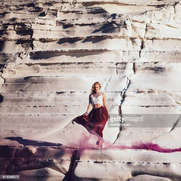 young bohemian woman with smoke bombs standing on white rock - czech model stock pictures, royalty-free photos & images