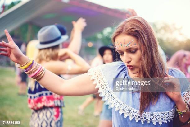 Young boho woman dancing at festival