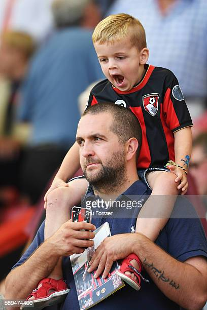 A young Bournemouth fan yawns prior to the Premier League match between AFC Bournemouth and Manchester United at Vitality Stadium on August 14 2016...