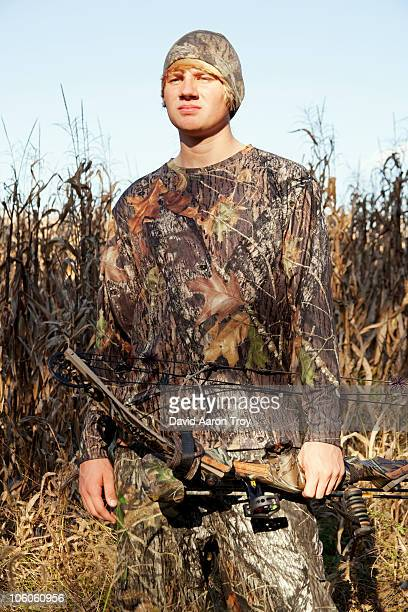 a young bowhunter - camouflage clothing stock pictures, royalty-free photos & images
