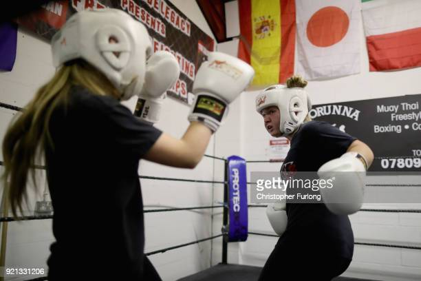 Young boxer Freya Fitzsimons aged 11 and Ellie Hyde 16 spar in the ring during training at the Hook Jab Boxing Gym on September 12 2016 in Warrington...