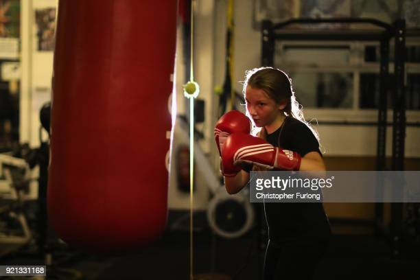 Young boxer Freya Fitzsimons aged 11 trains with a punch bag at the Hook Jab Boxing Gym on September 12 2016 in Warrington England The popularity of...