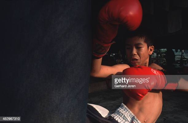 A young boxer from Sid Chasert gym in Mae Sot working out The boxers here have twohour six kilometer runs at 6am and 4pm The rigorous routine pushes...